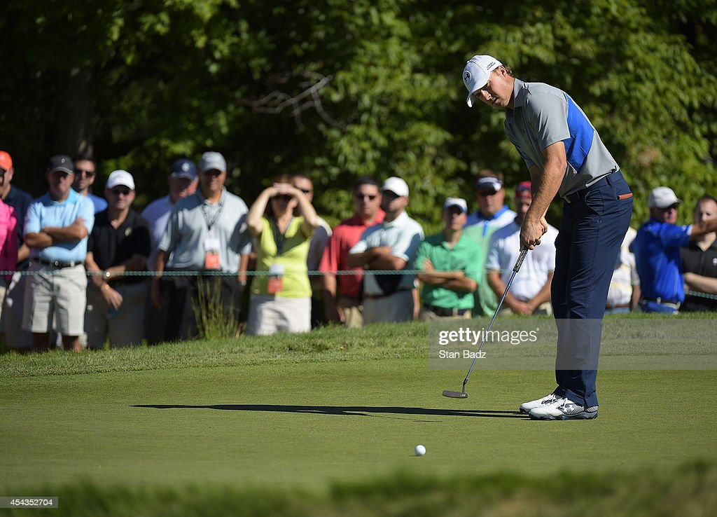 <a gi-track='captionPersonalityLinkClicked' href=/galleries/search?phrase=Jordan+Spieth&family=editorial&specificpeople=5440480 ng-click='$event.stopPropagation()'>Jordan Spieth</a> hits a putt on the 13th hole during the first round of the Deutsche Bank Championship at TPC Boston on August 29, 2014 in Norton, Massachusetts.