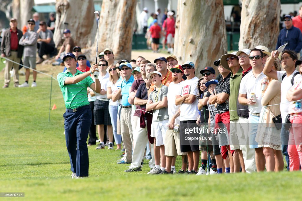 Jordan Spieth hits a shot from the fairway on the 8th hole in the third round of the Northern Trust Open at the Riviera Country Club on February 15...