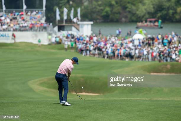 Jordan Spieth hits his approach shot in front of a large crowd on the par 5 twelfth hole during the third round of the WCGDell Technologies Match...