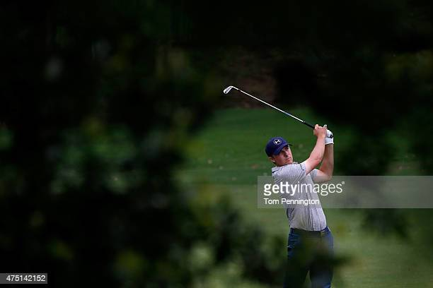 Jordan Spieth hits his second shot on the 12th hole during Round Two of the ATT Byron Nelson at the TPC Four Seasons Resort Las Colinas on May 29...