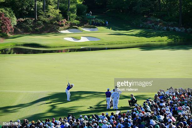 Jordan Spieth hits his tee shot on the 12th hole during the final round of the 2016 Masters Tournament at the Augusta National Golf Club on April 10...