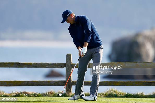 Jordan Spieth hits his tee shot on the 18th hole during the Final Round of the ATT Pebble Beach ProAm at Pebble Beach Golf Links on February 12 2017...