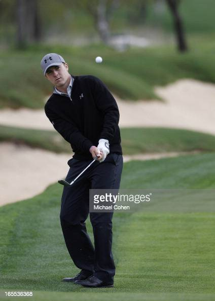 Jordan Spieth hits his third shot on the 14th hole during the first round of the Valero Texas Open held at the ATT Oaks Course at TPC San Antonio on...