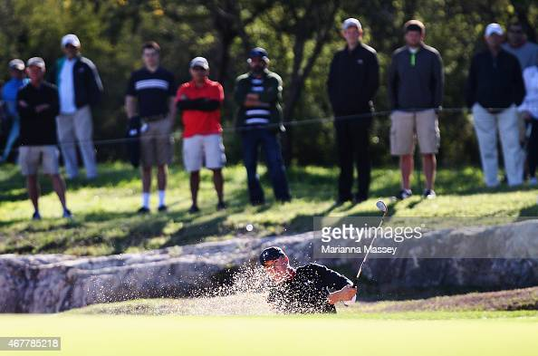 Jordan Spieth hits out of the bunker on the 14th hole during round two of the Valero Texas Open at TPC San Antonio ATT Oaks Course on March 27 2015...