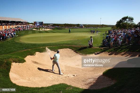 Jordan Spieth hits out of the bunker on the 18th hole during the final round of the Valero Texas Open at TPC San Antonio ATT Oaks Course on March 29...