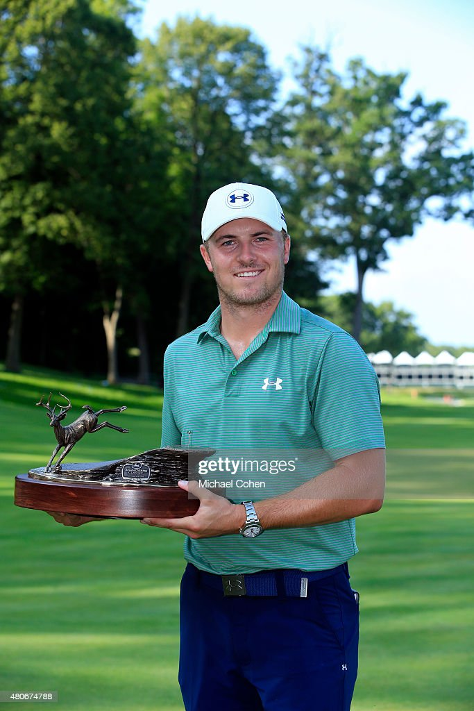Jordan Spieth holds the trophy after winning the John Deere Classic during the final round of the John Deere Classic held at TPC Deere Run on July 12, 2015 in Silvis, Illinois.