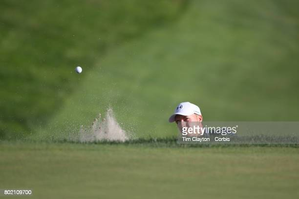 Jordan Spieth holes from the sand trap on the eighteenth during first play off hole play off during the fourth round of the Travelers Championship...
