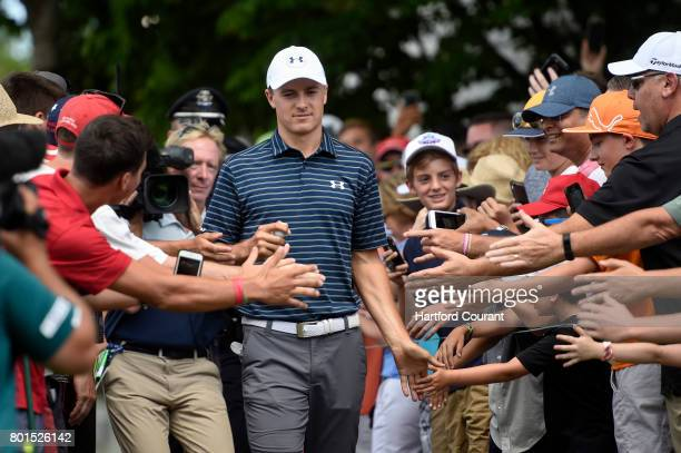 Jordan Spieth is greeted by fans on the first tee during the final round of the 2017 Travelers Championship at TPC River Highlands Sunday June 25...
