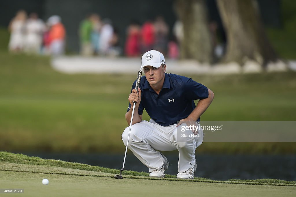 Jordan Spieth lines up a birdie attempt putt on the 17th hole island green during the third round of THE PLAYERS Championship on THE PLAYERS Stadium Course at TPC Sawgrass on May 10, 2014 in Ponte Vedra Beach, Florida.