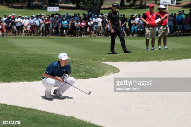 Jordan Spieth lines up his bunker shot at the final round of the 102nd Australian Open Golf Championship at The Australian Golf Club in Sydney on...