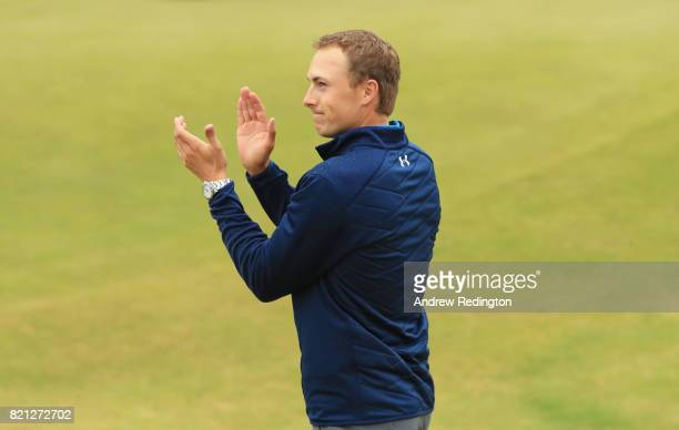 Jordan Spieth of the United States acknowledges the applause from the crowd as he walks onto the 18th green to receive the Claret Jug during the...