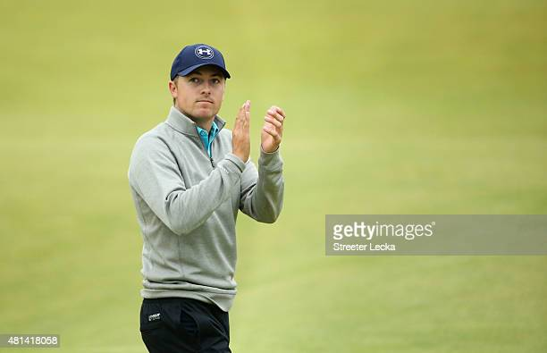 Jordan Spieth of the United States acknowledges the crowd on the 18th green during the final round of the 144th Open Championship at The Old Course...