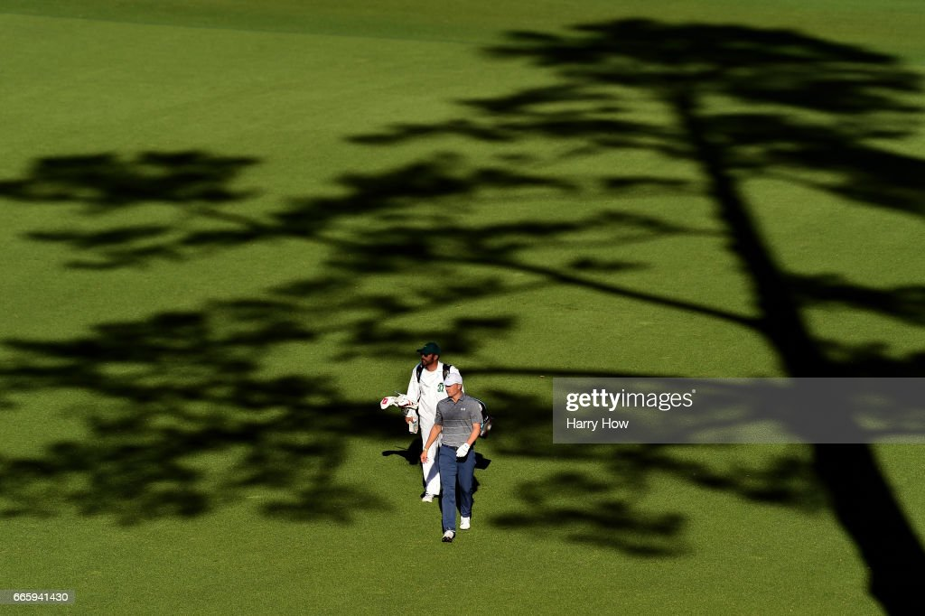 Jordan Spieth of the United States and caddie Michael Greller walk to the 14th tee during the second round of the 2017 Masters Tournament at Augusta National Golf Club on April 7, 2017 in Augusta, Georgia.