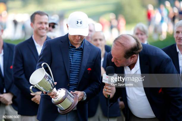 Jordan Spieth of the United States and Chris Berman check out the winner's names from decades gone by during the final round of the Travelers...