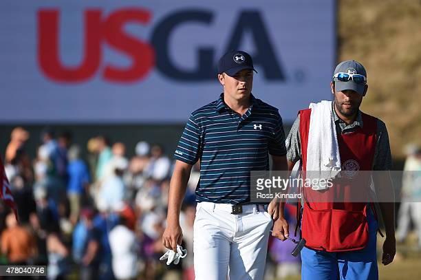 Jordan Spieth of the United States and his caddie Michael Greller walk together on the 17th hole during the final round of the 115th US Open...