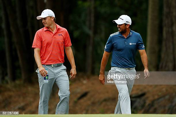 Jordan Spieth of the United States and Jason Day of Australia walk together up the tenth fairway during the second round of THE PLAYERS Championship...