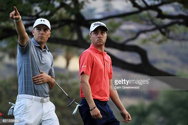 Jordan Spieth of the United States and Justin Thomas of the United States walk during the first round of the Sony Open In Hawaii at Waialae Country...