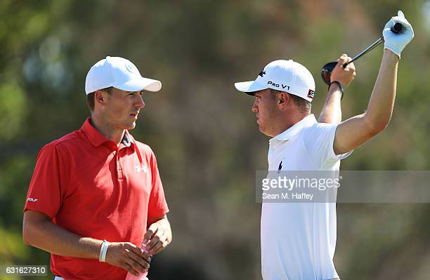Jordan Spieth of the United States and Justin Thomas of the United States talk on the first tee during the second round of the Sony Open In Hawaii at...