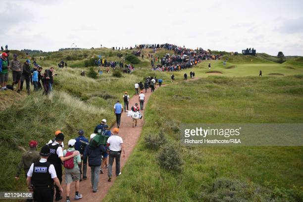 Jordan Spieth of the United States and Matt Kuchar of the United States walk to the 12th green during the final round of the 146th Open Championship...
