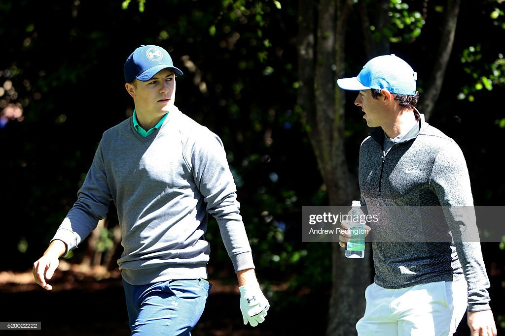 Jordan Spieth of the United States and Rory McIlroy of Northern Ireland walk on the second hole during the third round of the 2016 Masters Tournament...