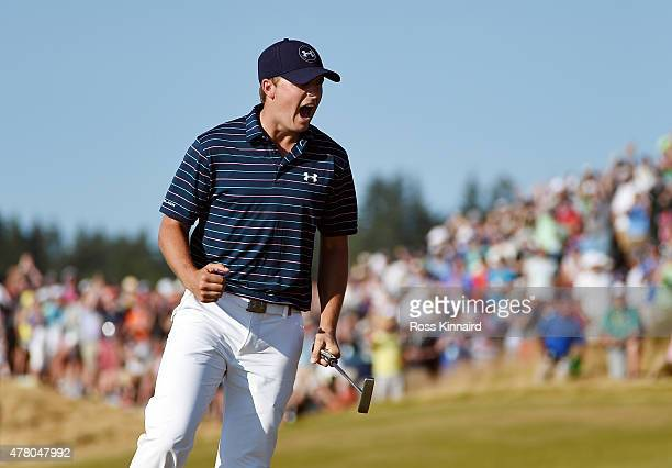 Jordan Spieth of the United States celebrates a birdie putt on the 16th green during the final round of the 115th US Open Championship at Chambers...