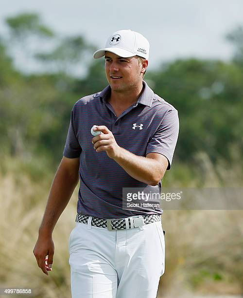 Jordan Spieth of the United States celebrates after a holeinone on the second hole during the first round of the Hero World Challenge at Albany The...