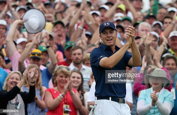 Jordan Spieth of the United States celebrates on the 18th green after his fourstroke victory at the 2015 Masters Tournament at Augusta National Golf...