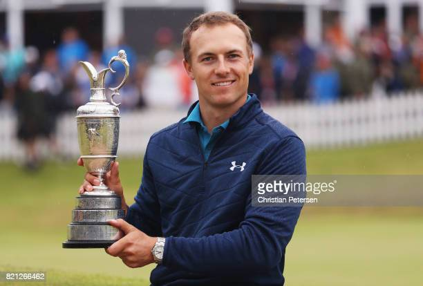 Jordan Spieth of the United States celebrates victory as he poses with the Claret Jug on the 18th green during the final round of the 146th Open...