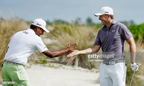 Jordan Spieth of the United States celebrates with Anirban Lahiri of India after a Spieth had a holeinone on the second hole during the first round...