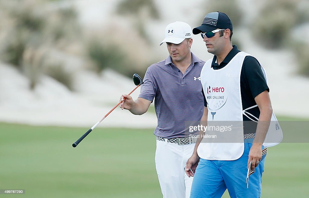 Jordan Spieth of the United States chats with his caddie Michael Greller on the third hole during the first round of the Hero World Challenge at Albany, The Bahamas on December 3, 2015 in Nassau, Bahamas
