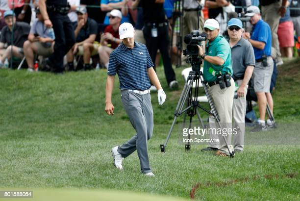 Jordan Spieth of the United States checks the location of his drive on 15 which somehow stayed out of the hazard during the final round of the...