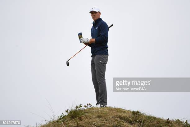 Jordan Spieth of the United States checks the yardage and playing line on the 13th hole during the final round of the 146th Open Championship at...