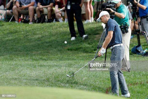 Jordan Spieth of the United States chips onto the 15th green during the final round of the Travelers Championship on June 25 at TPC River Highlands...