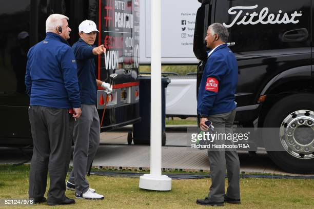 Jordan Spieth of the United States discusses a penalty drop on the practise range while playing the 13th hole with referees during the final round of...