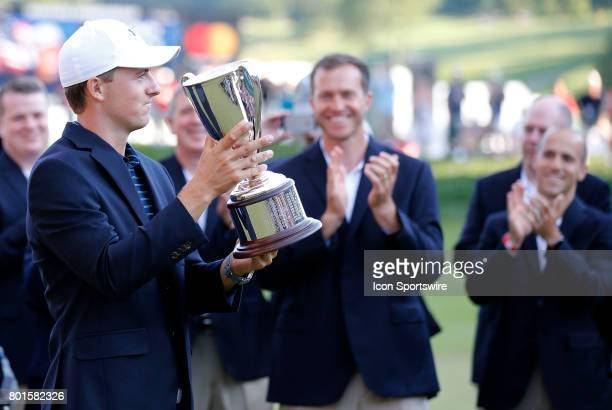 Jordan Spieth of the United States displays the hardware during the final round of the Travelers Championship on June 25 at TPC River Highlands in...