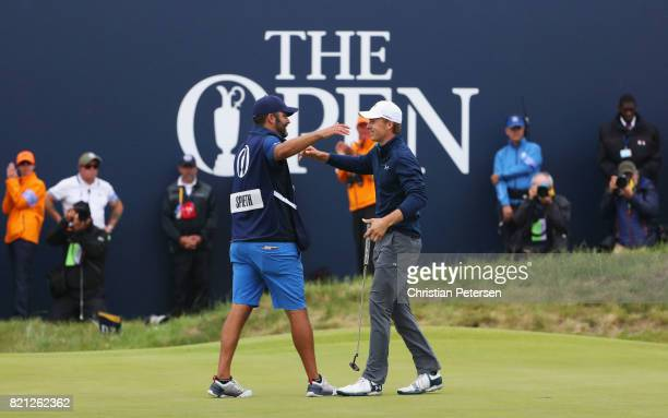 Jordan Spieth of the United States embraces his caddie Michael Greller after victory on the 18th green during the final round of the 146th Open...