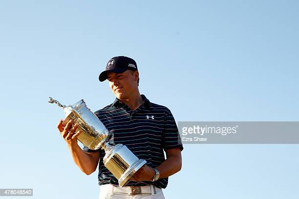 Jordan Spieth of the United States glances at the trophy after winning the 115th US Open Championship at Chambers Bay on June 21 2015 in University...
