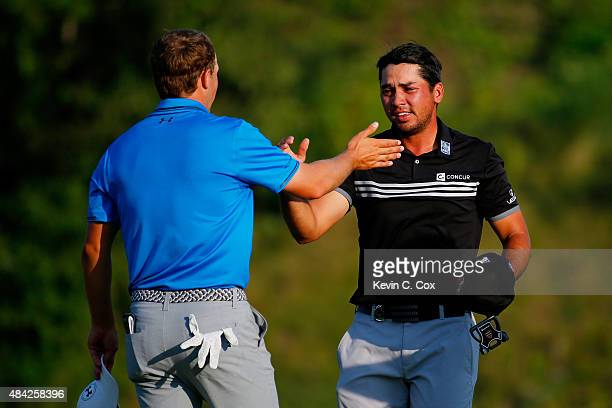 Jordan Spieth of the United States greets Jason Day of Australia after Day's threestroke victory at the 2015 PGA Championship at Whistling Straits on...