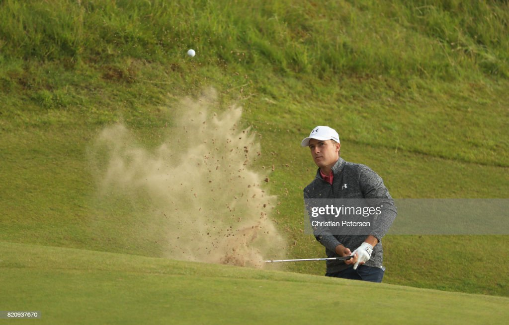 Jordan Spieth of the United States hits a bunker shot on the 17th hole during the third round of the 146th Open Championship at Royal Birkdale on July 22, 2017 in Southport, England.