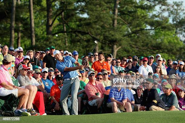 Jordan Spieth of the United States hits a pitch shot on the 18th hole during the third round of the 2015 Masters Tournament at Augusta National Golf...