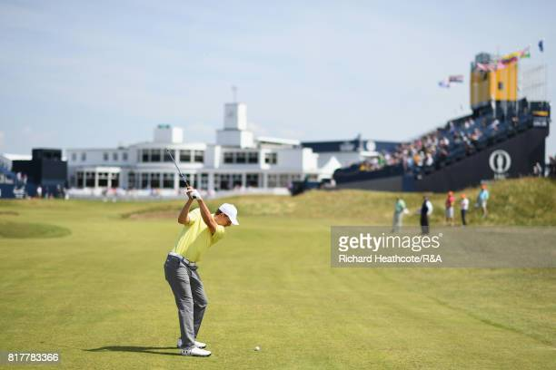 Jordan Spieth of the United States hits an approach shot on the 18th hole during a practice round prior to the 146th Open Championship at Royal...