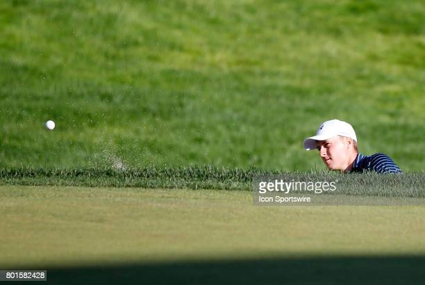 Jordan Spieth of the United States hits from the bunker on 18 to win the Travelers Championship on June 25 at TPC River Highlands in Cromwell...