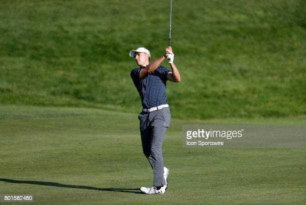 Jordan Spieth of the United States hits his approach shot on the 18th fairway during the final round of the Travelers Championship on June 25 at TPC...