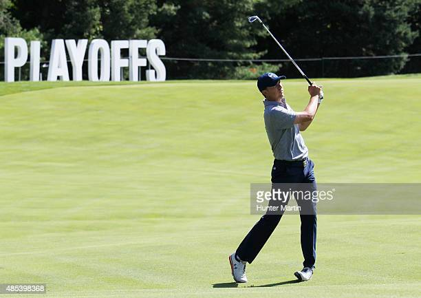 Jordan Spieth of the United States hits his second shot on the 18th hole during the first round of The Barclays at Plainfield Country Club on August...