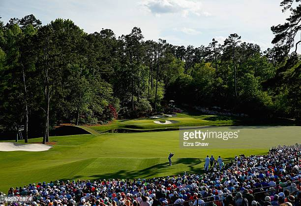 Jordan Spieth of the United States hits his tee shot on the 12th hole as Charley Hoffman of the United States looks on during the third round of the...