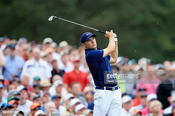Jordan Spieth of the United States hits his tee shot on the 12th hole during the final round of the 2015 Masters Tournament at Augusta National Golf...