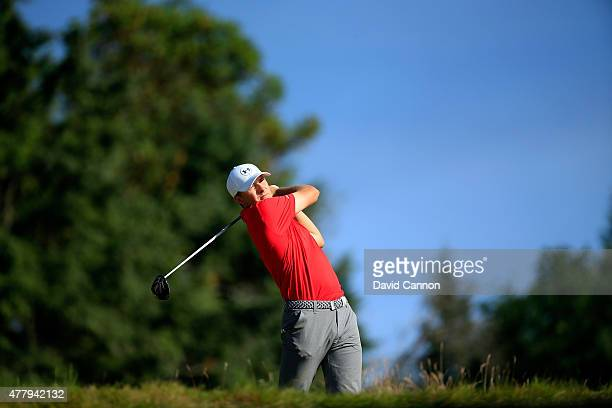 Jordan Spieth of the United States hits his tee shot on the 14th hole during the third round of the 115th US Open Championship at Chambers Bay on...