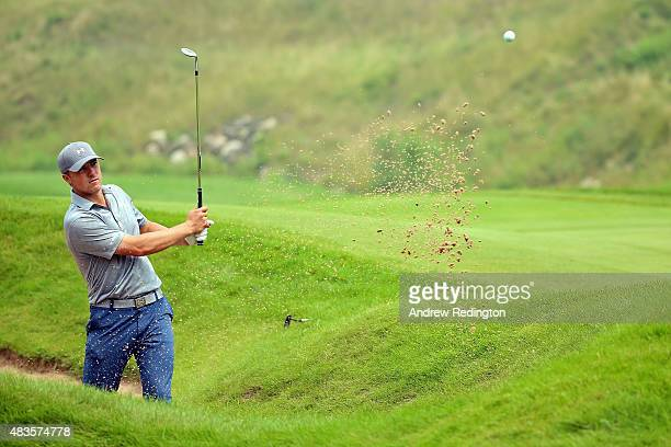 Jordan Spieth of the United States hits out of a bunker during a practice round prior to the 2015 PGA Championship at Whistling Straits on August 10...