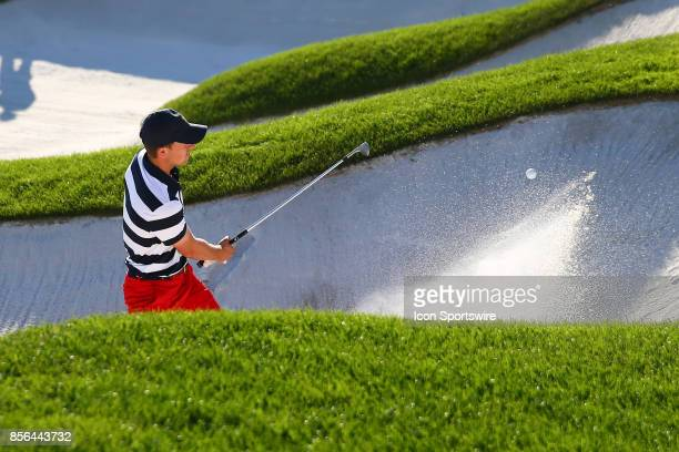 Jordan Spieth of the United States hits out of the sand on the 14th hole during the Presidents Cup on October 1 at Liberty National Golf Club in...