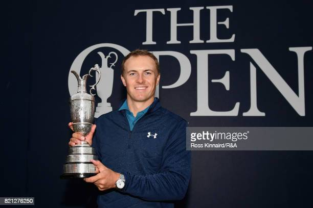Jordan Spieth of the United States holds the Claret Jug after winning the 146th Open Championship at Royal Birkdale on July 23 2017 in Southport...